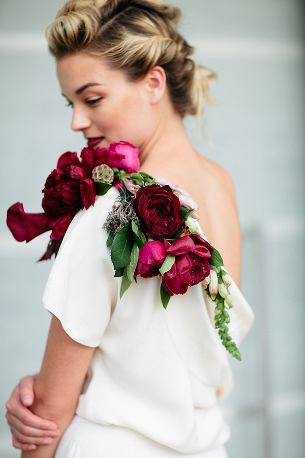 Red-and-fuchsia shoulder corsage