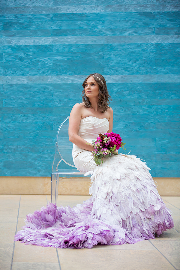 Feathered bridal gown with a purple ombre effect