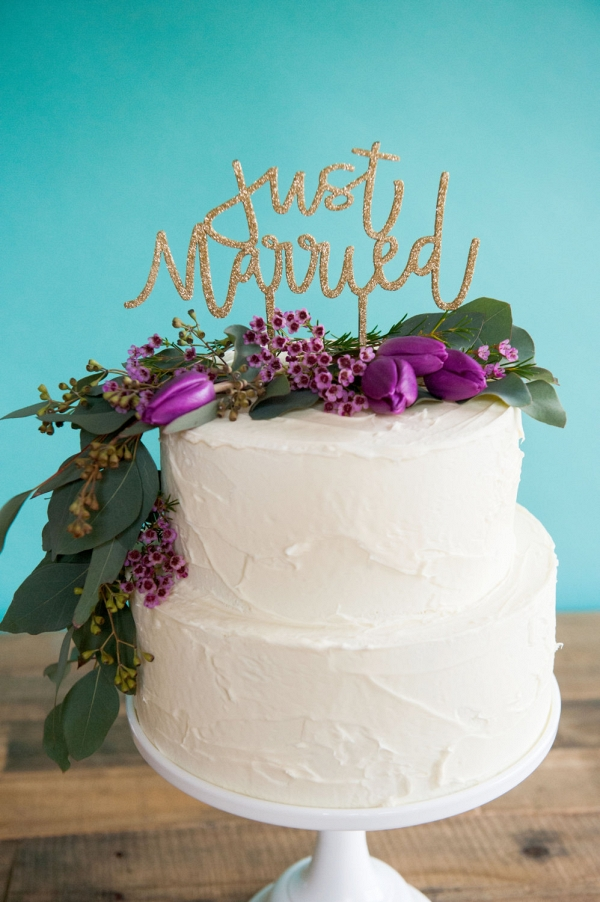 Glittery cake topper that spells out your just-married status