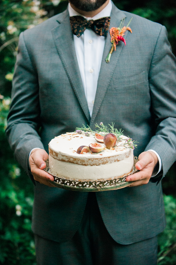Nearly naked cake topped with figs and herbs