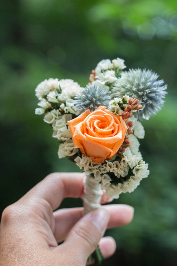 Peach Rose And Thistle Boutonniere