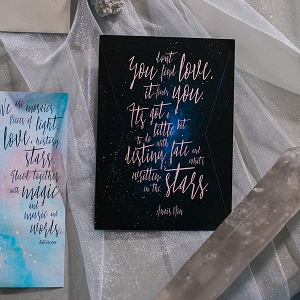 Constellational wedding invitation with typography inspired by astrological symbols