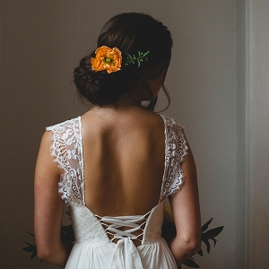 Chic chignon adorned with an orange poppy
