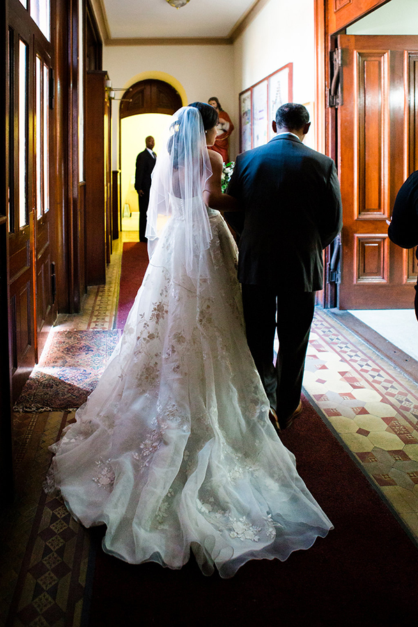A bride and her father prepare to walk down the aisle