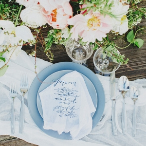 An oceanic place setting with a calligraphed acrylic menu