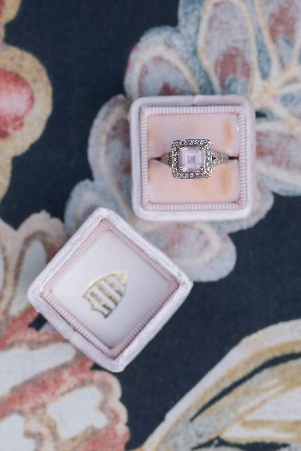 Pink stone engagement ring in a velvet ring box