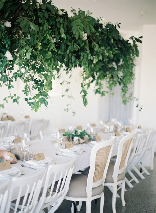 Rustically elegant tablescape with suspended greenery