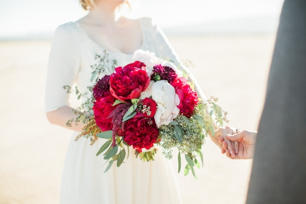 A bouquet of red peonies for a desert elopement in Las Vegas