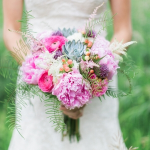 Earthy spring bouquet with pink peonies, succulents, scabiosas, ferns, and astilbe