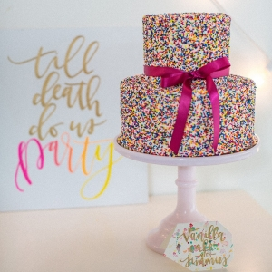 Colorful wedding cake covered in sprinkles