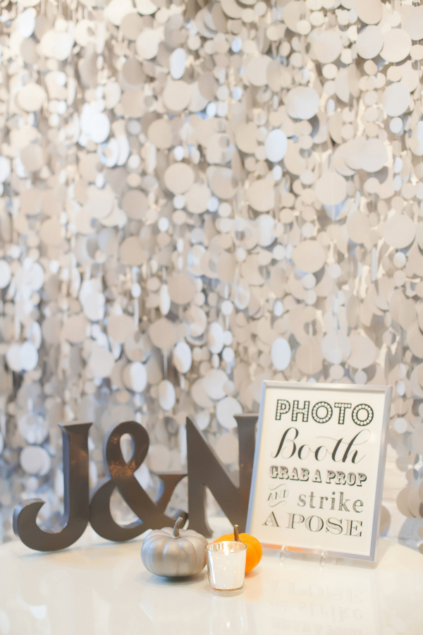 Confetti-inspired photo booth backdrop for an urban autumn wedding