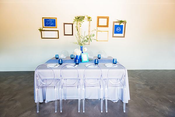 Minimalist tablescape with blue details and ghost chairs