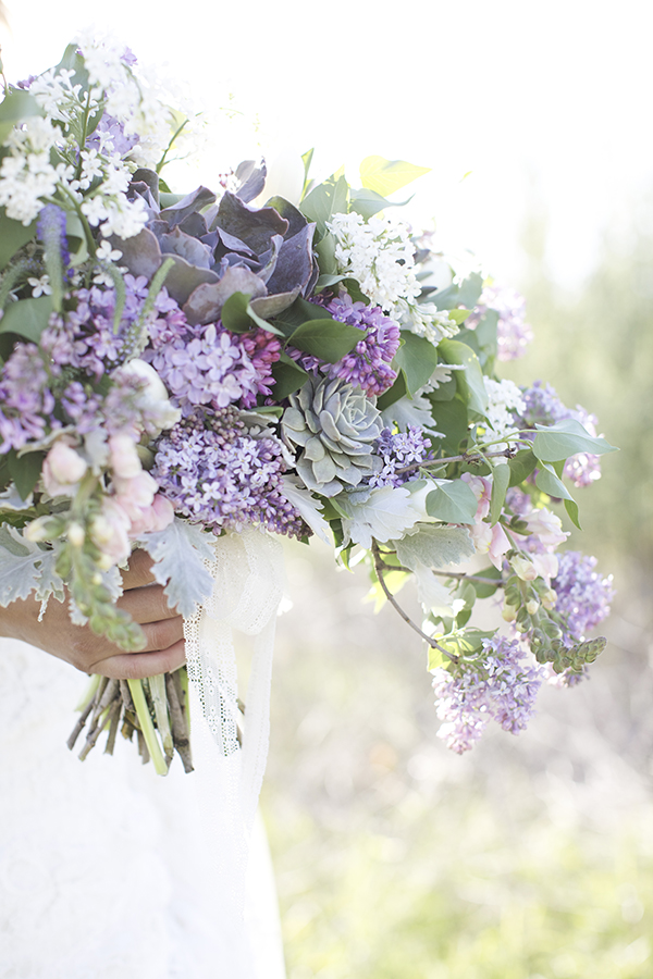 An earthy spring bouquet with lilacs and succulents