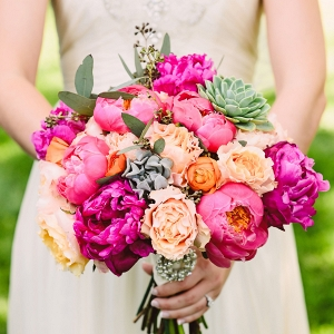 Bright spring bouquet with peonies, succulents, and garden roses