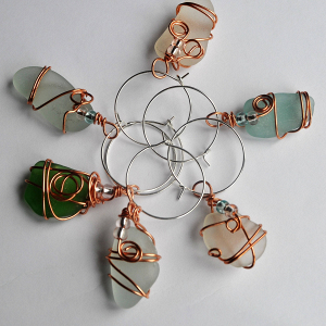 Wine glass charms made from wire-wrapped Scottish sea glass