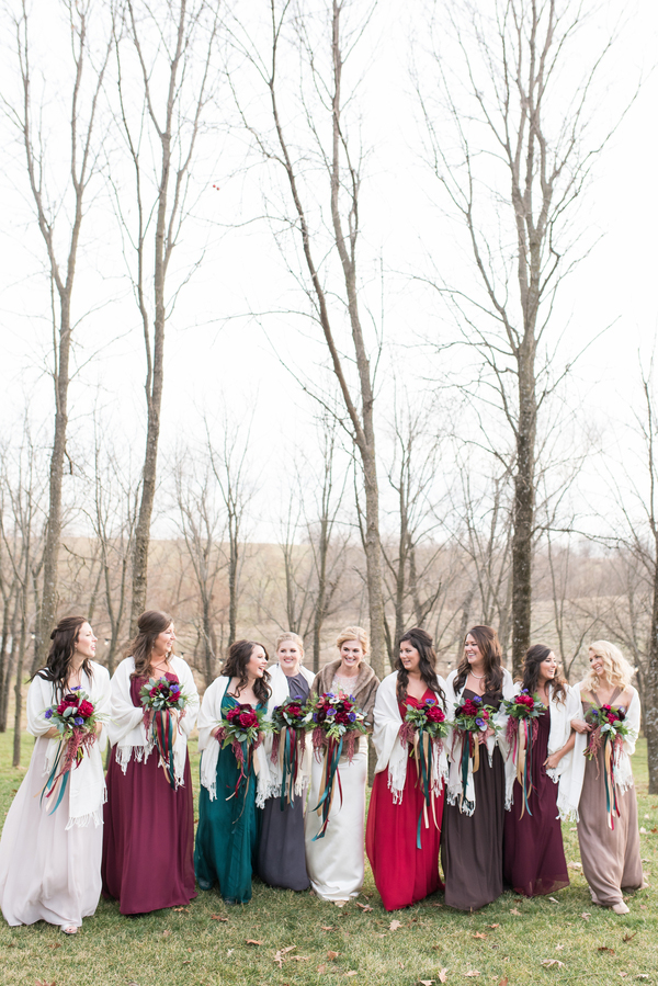 Winter bridesmaids in jewel-toned dresses