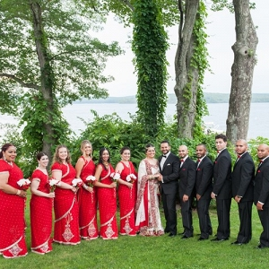 Bridesmaids and Groomsmen Posing at the Lake Before Wedding