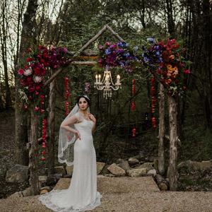 Bride under wood arch