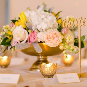 Peach, yellow, and gold wedding centerpiece