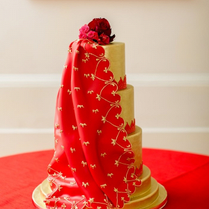 Red and gold draped wedding cake