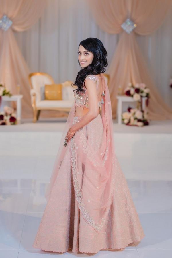 Indian bride in blush pink lehenga