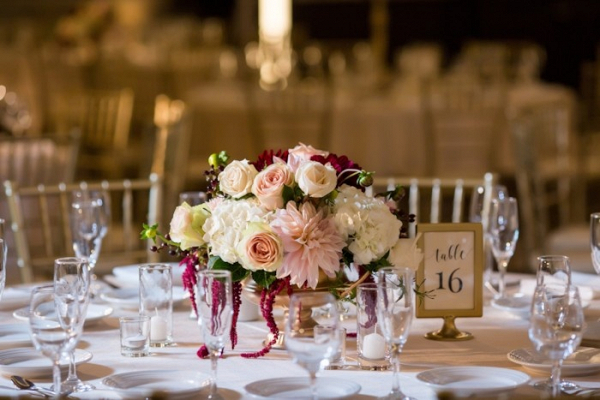 Classic pink and burgundy floral centerpiece