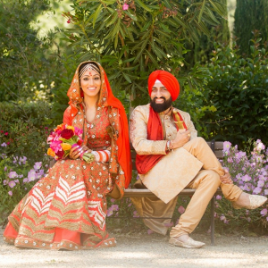 Orange and red Sikh wedding