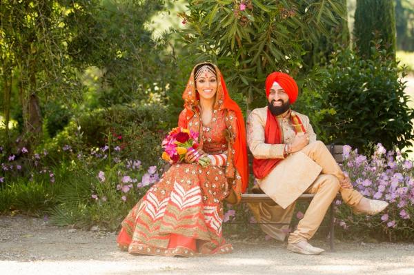 Orange and red Sikh wedding
