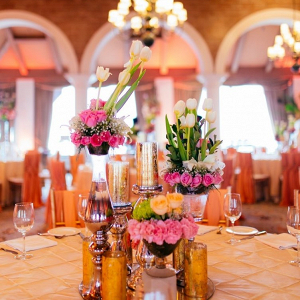 Modern orange and pink centerpiece on The Big Fat Indian Wedding