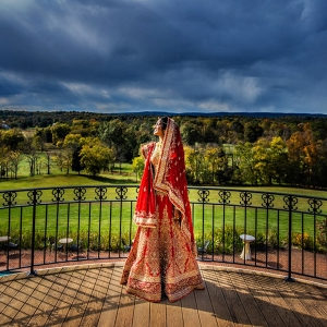 Indian Bride on Balcony Overlooking Estate