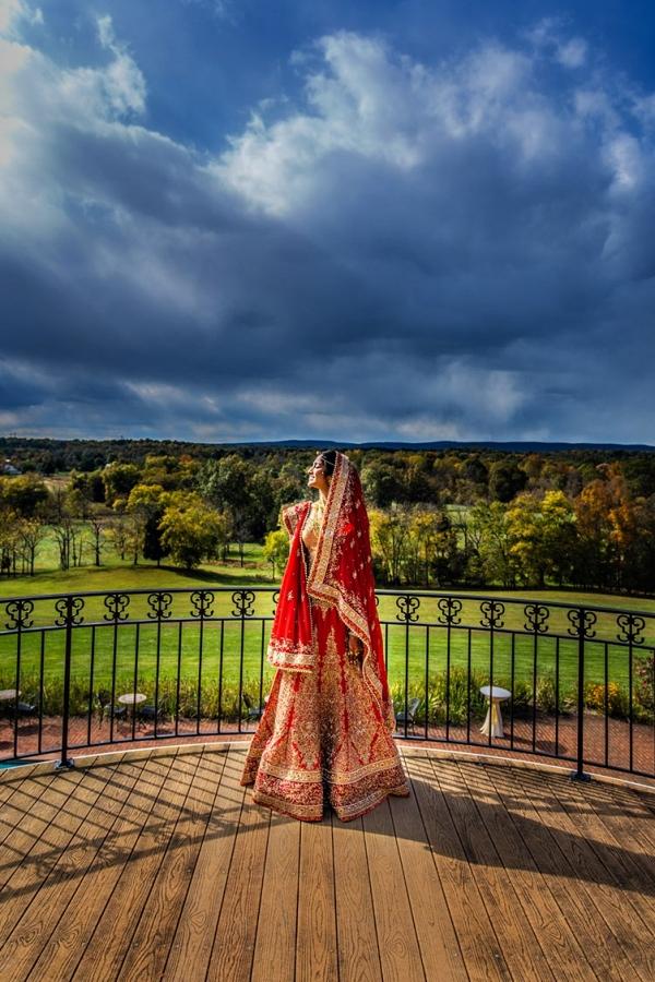 Indian Bride on Balcony Overlooking Estate