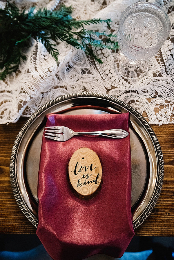 Wedding tablescape with cranberry napkin