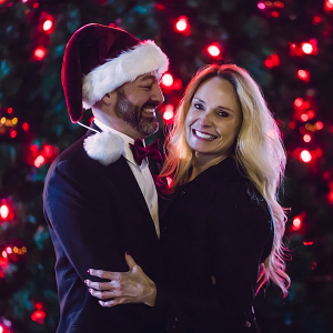 engagement photos in front of Christmas tree