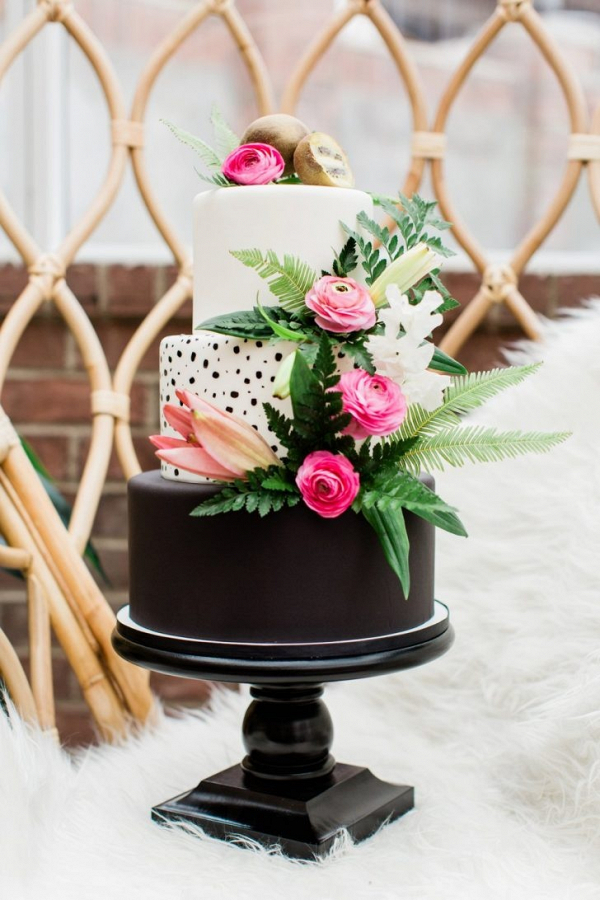 Tropical black and white wedding cake with pink florals