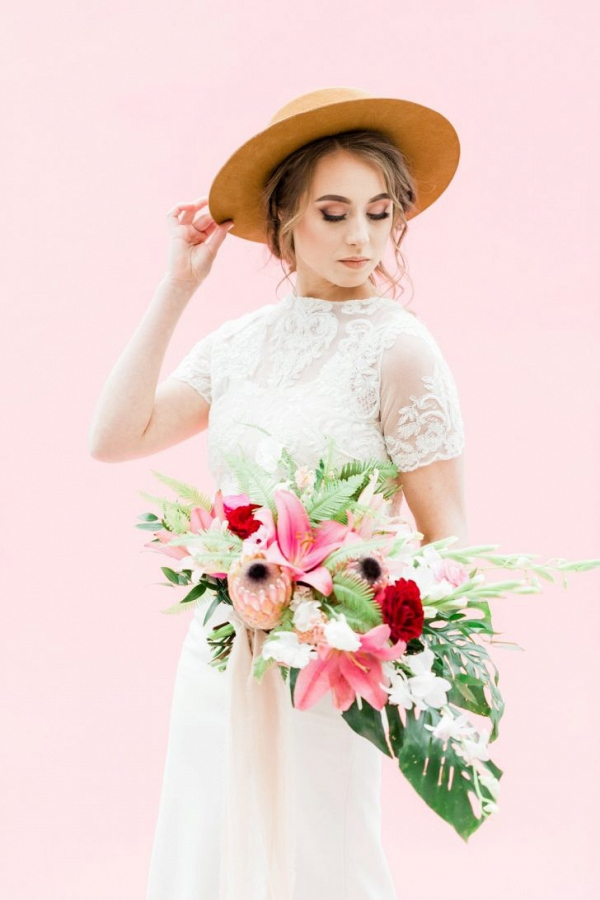 Hip bride with tropical bouquet