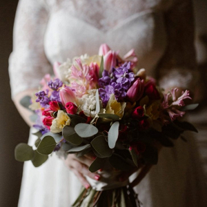 Pink, yellow, and purple bridal bouquet