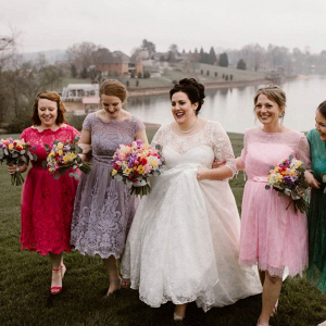 Bridesmaids in colorful vintage lace dresses