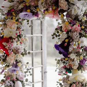 Floral arch with colorful paper bells