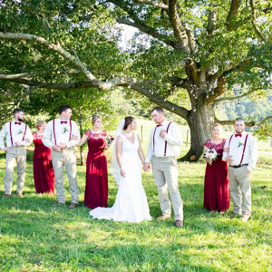 Bridal party with red bridesmaid dresses