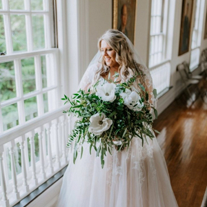 Bride with oversized greenery bouquet