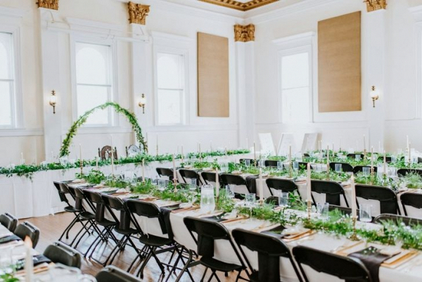 Wedding reception with long tables and greenery runners