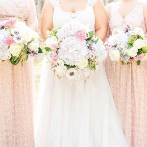 Bridesmaids in blush sequin dresses