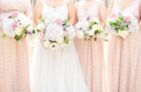 Bridesmaids in blush sequin dresses