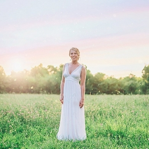 Bride in v neck wedding gown on The Budget Savvy Bride