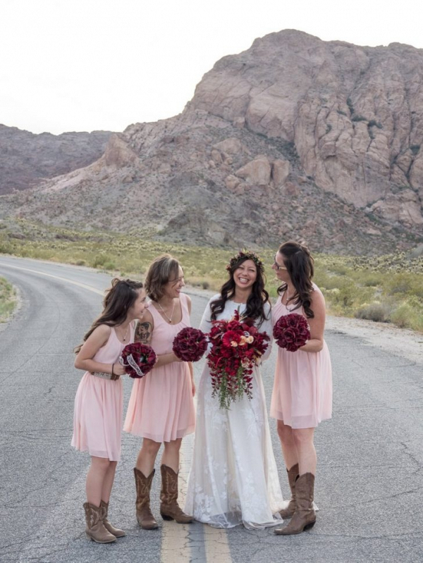 Bridesmaids in pink dresses and cowboy boots