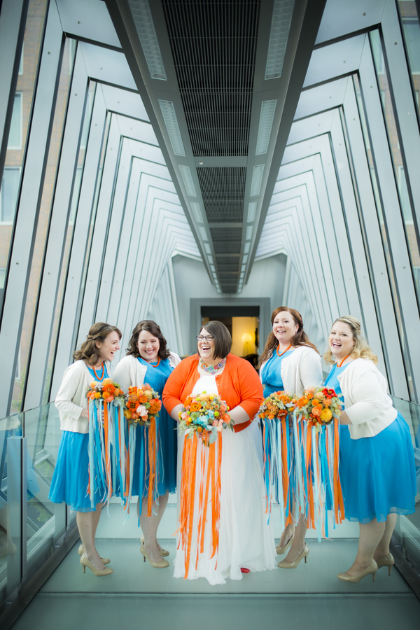 Colorful orange wedding shot by Amy Ann Photography