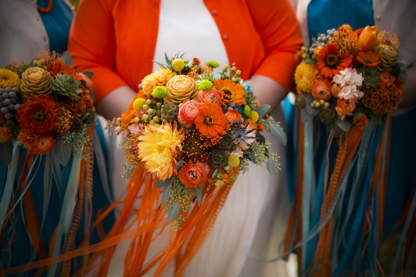Colorful orange wedding bouquet shot by Amy Ann Photography