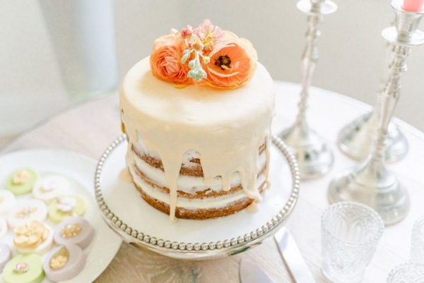 Drip wedding cake with fresh flower topper