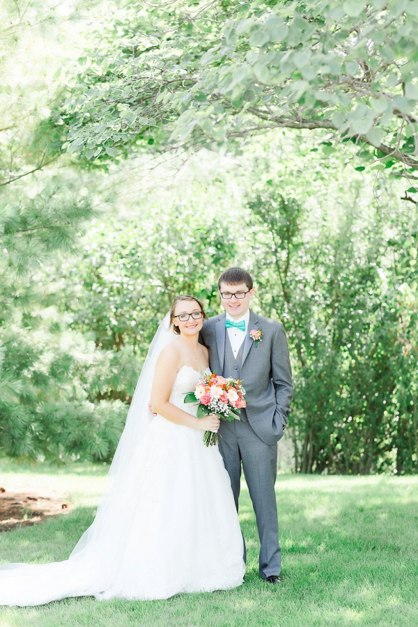 Coral and teal wedding couple