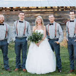 Bride with groomsmen in bow ties